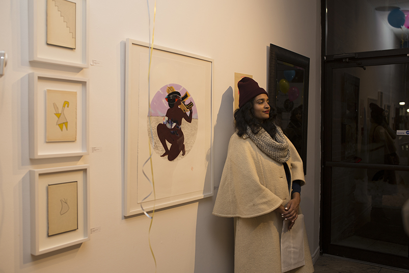 Artist Rajni Perera beside her work
